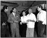 Robert Taylor (far left) , John Farrow, Ava Gardner at his side---THANKS CM!