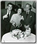 Victor Mature, John Farrow and Jane Nigh celebrate her birthday during the filming of Red, Hot, and Blue