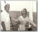 John Farrow and Lana Turner while filming The Sea Chase  1955