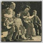 John Farrow, Mia on his lap, Patrick, Maureen O'Sullivan holding John Jr. and  Michael