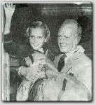 Leaving the hospital after stricken with polio---Mia Farrow and dad John