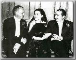 John Farrow, Maureen O'Sullivan, and Jack Warner (?)
