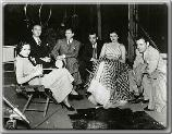 Maureen O'Sullivan on the set of The Thin Man seated with co-stars Bill Powell and Myrna Loy
