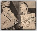 John Farrow shows Hitler--played by Bob Watson--the headlines of his downfall.