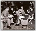 Joseph Calliea, John Farrow, Script girl Gloria, and Sally Eilers reading over lines for a scene---Full Confession.