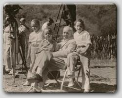 Farrow with his daughters on location